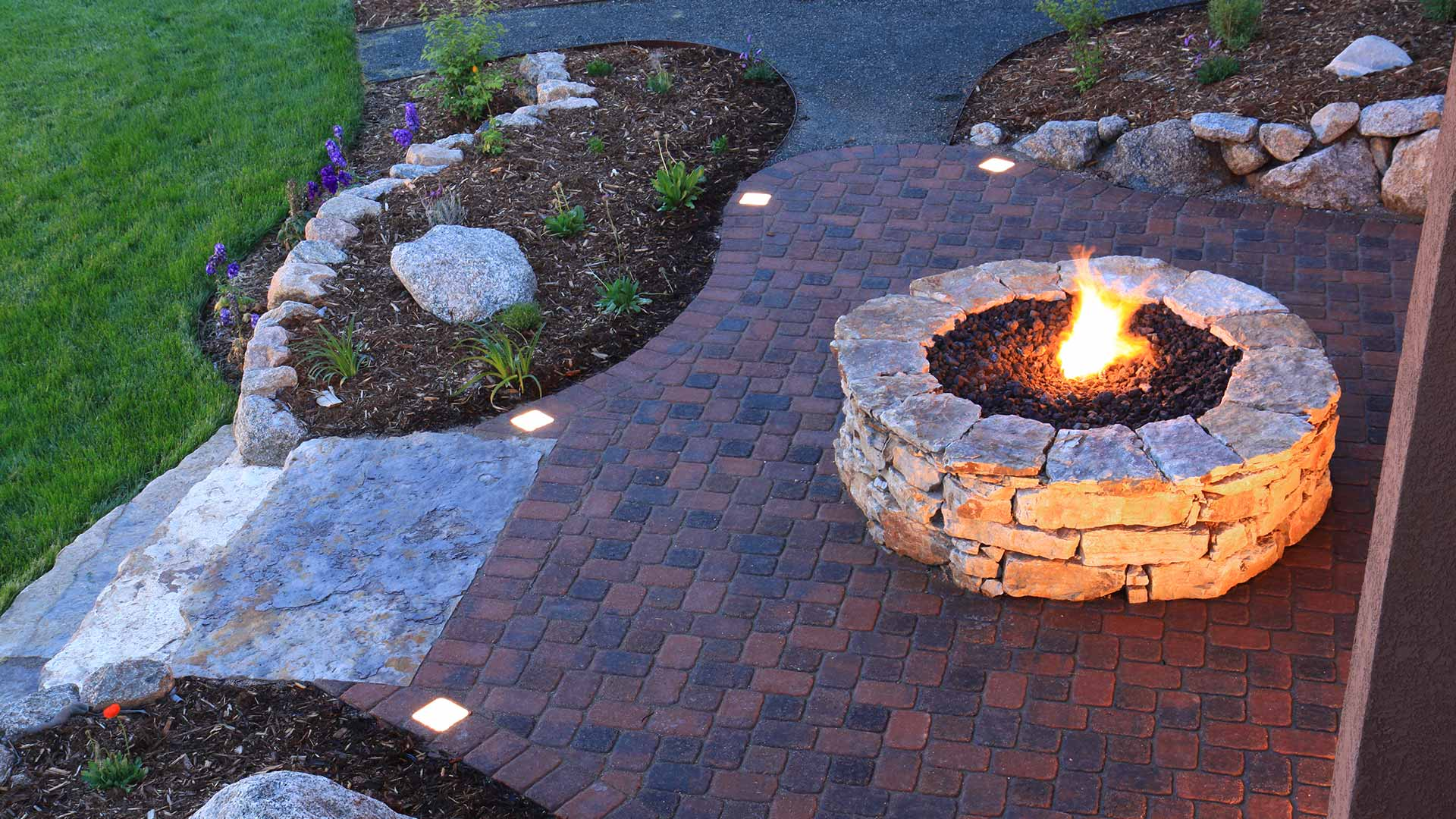 Custom fire pit and patio installation at a Orlando, FL home.