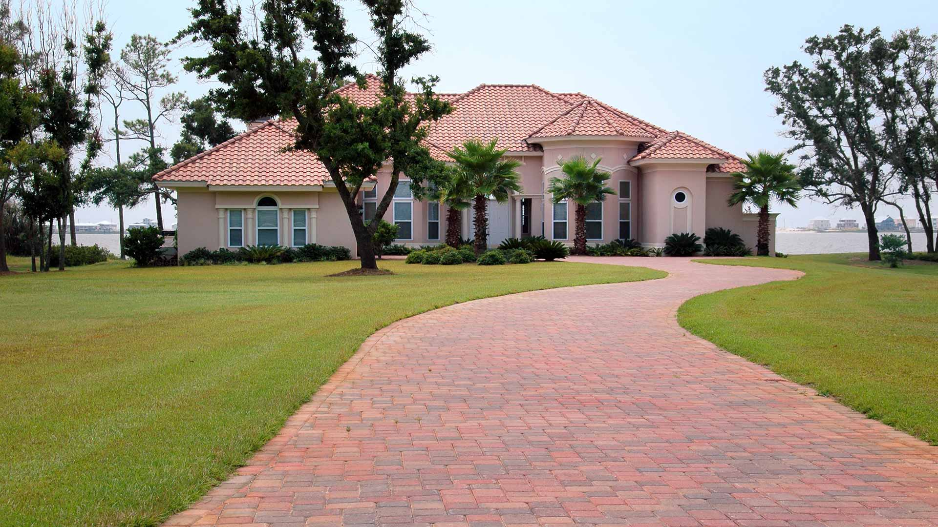 Beautiful decorative paver driveway leading up to a house in Orlando, FL.