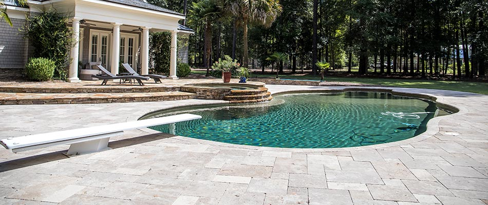 Stone paver pool patio deck and diving board near Clermont, FL.