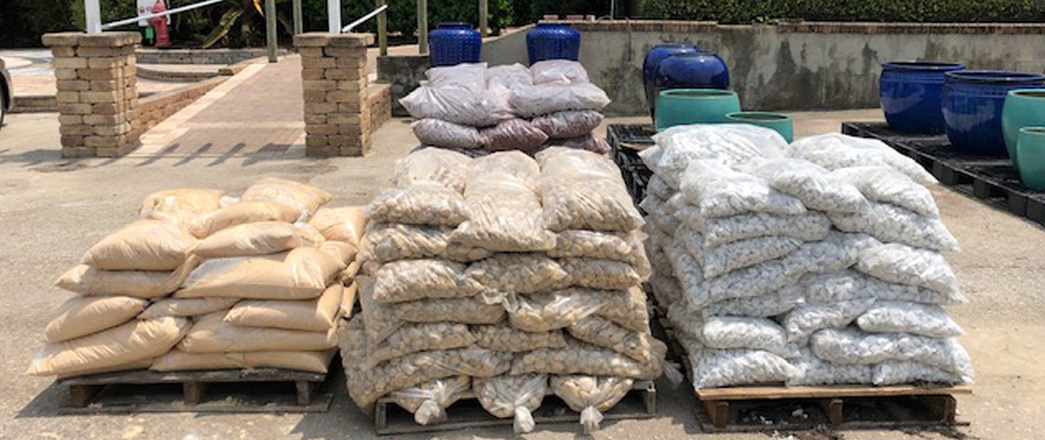 Bags of mulch and rock available for pick up at our nursery in Orlando, FL.