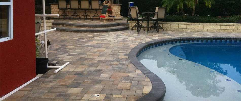 Custom patio construction around a home pool in The Villages, FL.