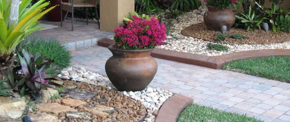 Decorative river rock we installed in a landscaping bed in front of a home in The Villages.