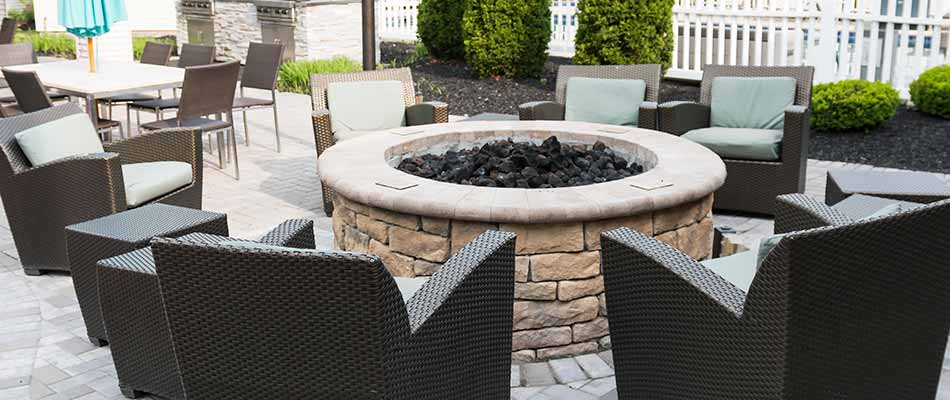 A stone fire pit and custom patio construction at a Clermont, FL property.