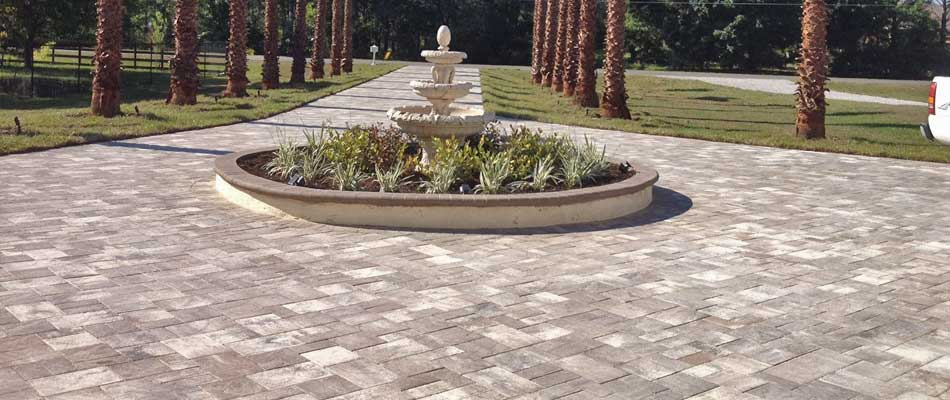 New driveway installed with decorative pavers at a residential property in The Villages, FL.