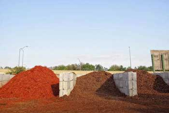 Bulk mulch at our nursery that comes in red, brown, and black.